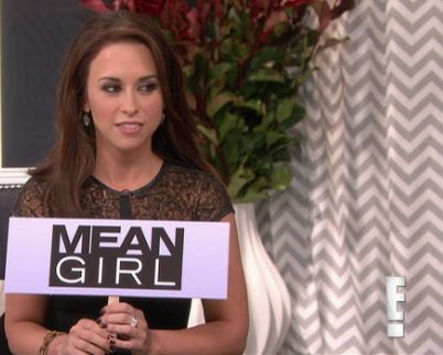 Lacey Chabert holding mean girl sign on Marie Osmond Show