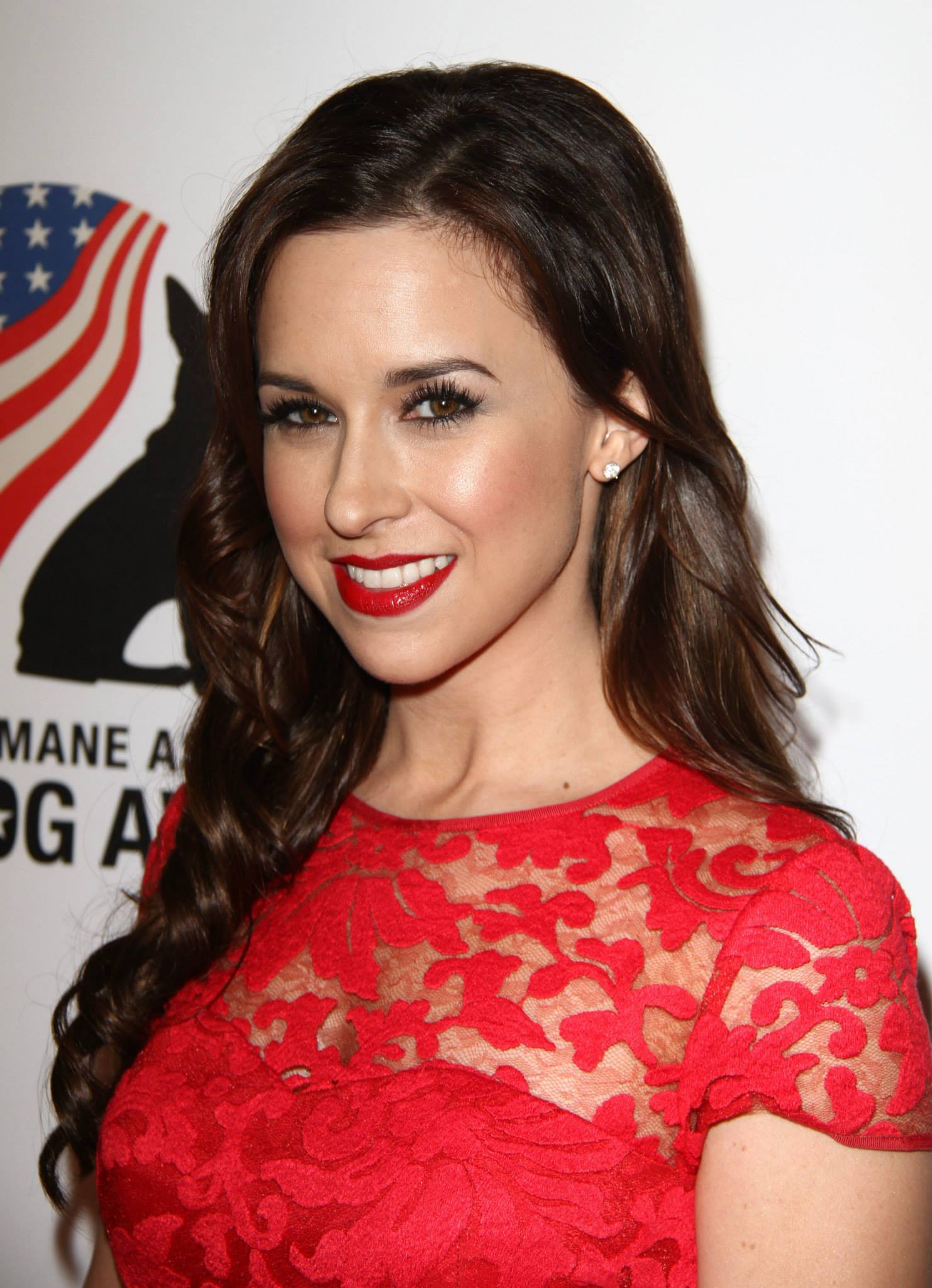 Lacey Chabert in a red dress on the red carpet