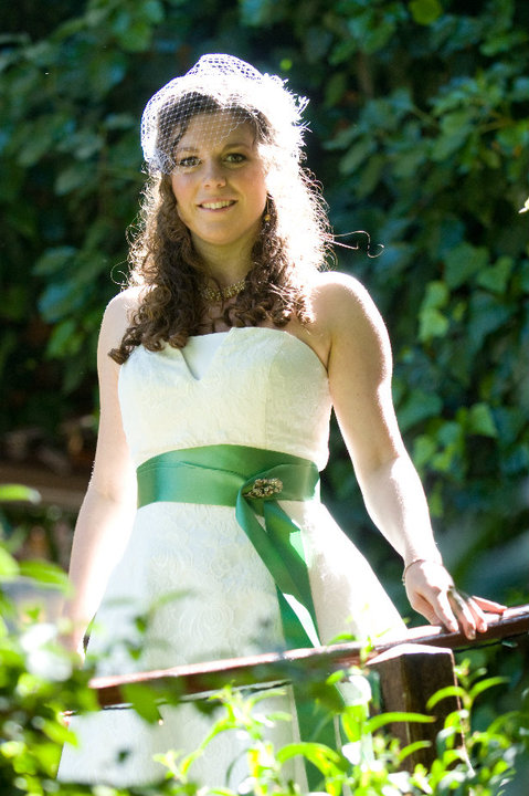 bride white dress with green background in the sun
