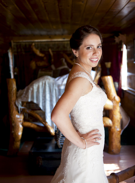 bride's formal white gown in dark wood room