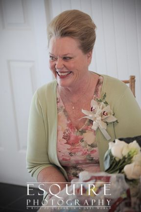 proud smiling mother of the soon to be wed