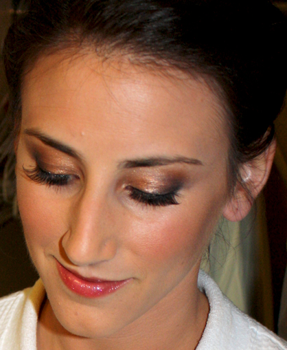 bride looking down with makeup