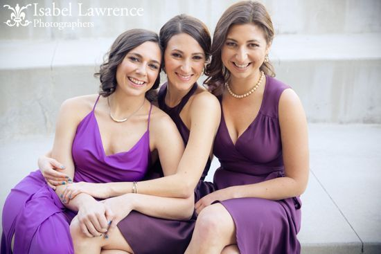 bridesmaids in purple gowns